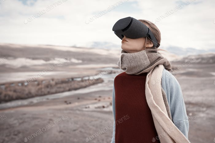 Woman Travels In Virtual Reality. Wild Nature At Background.