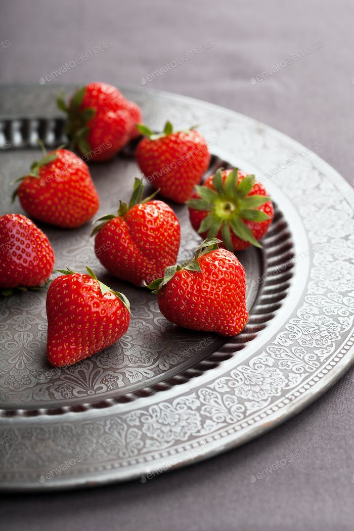 strawberry on vintage plate