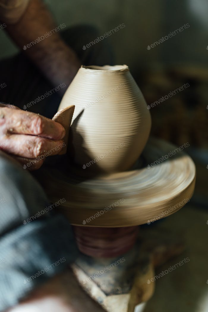 The ceramist make vase from clay