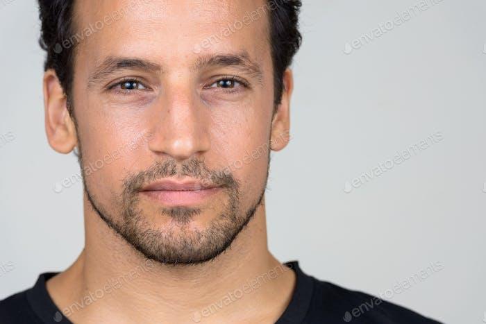 Portrait of handsome bearded Hispanic man