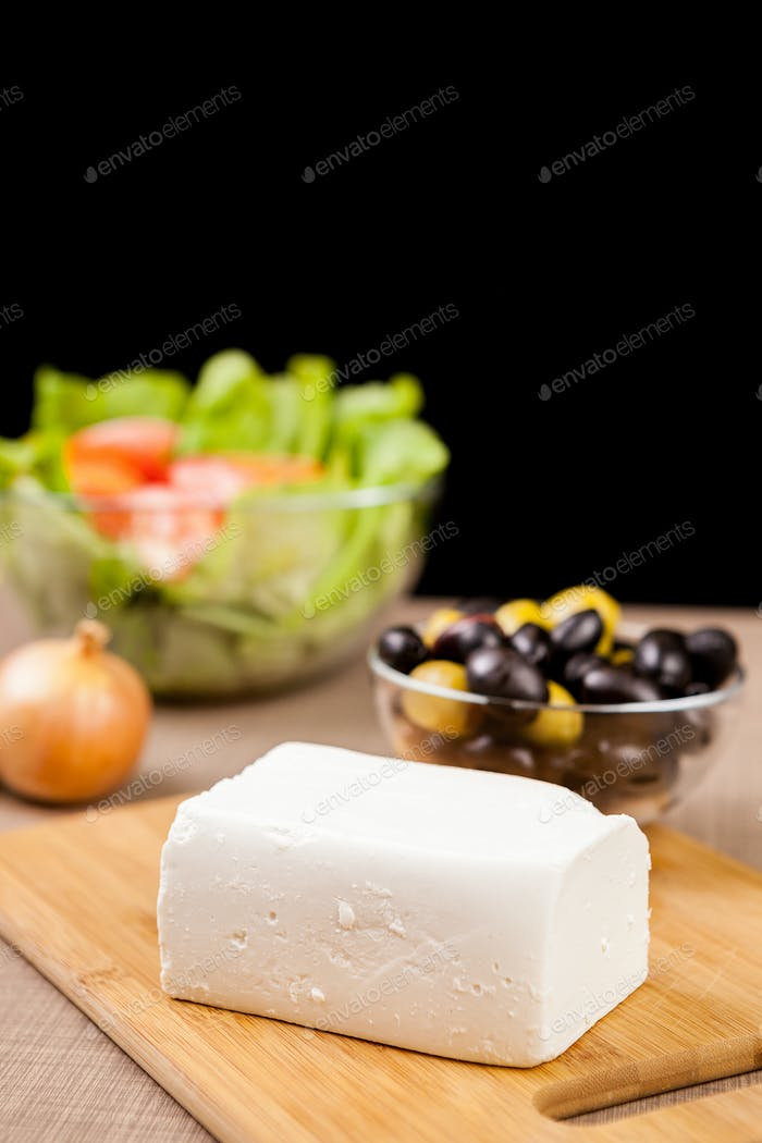 Close up of feta cheese on wooden board