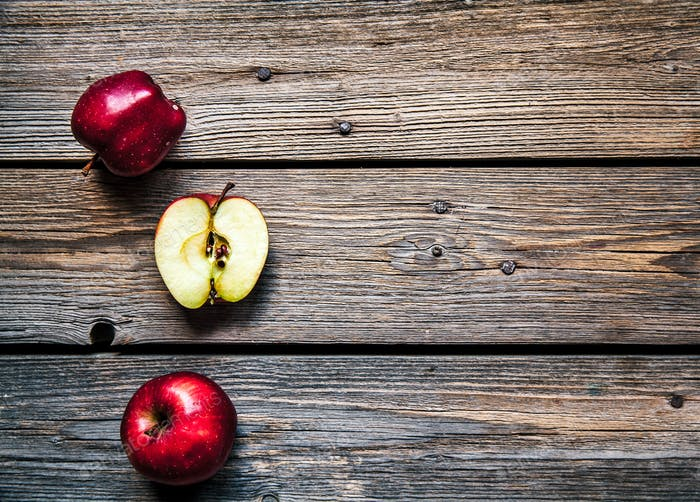 Fresh red apples on wooden table. fruit, natural food. Free space for text . Top view