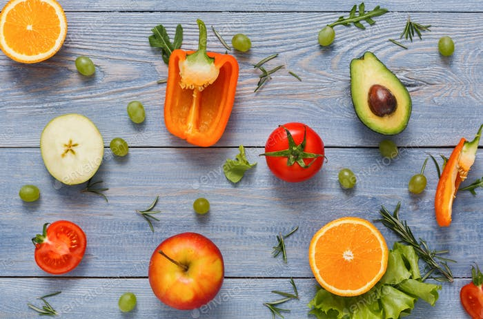 Pattern of fresh vegetables on blue wood background with copy space