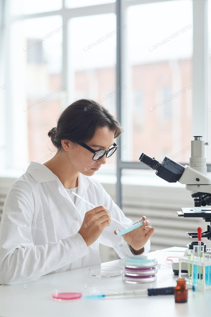Female Student Working in Laboratory