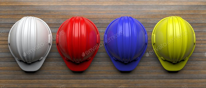 Hard hats various colors on wood, top view. 3d illustration