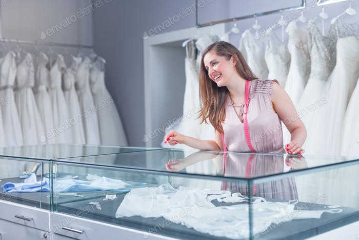Young seller in a wedding shop