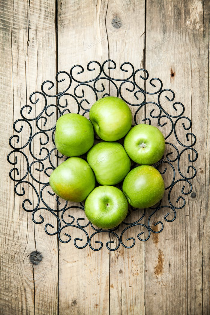 fruit. apples in a bowl on wooden background