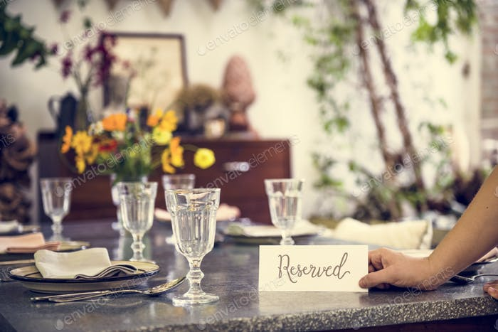 Restaurant table setting service with reserved card