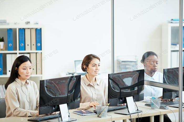 Row of Female Operators in Call Center