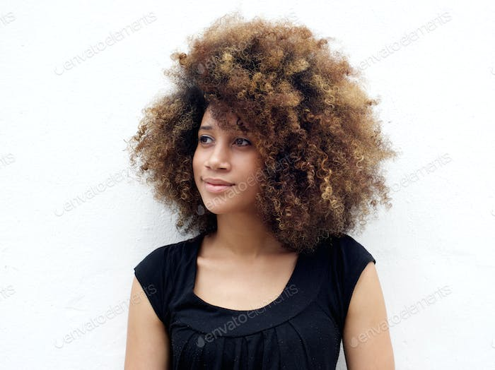 Afro woman looking away