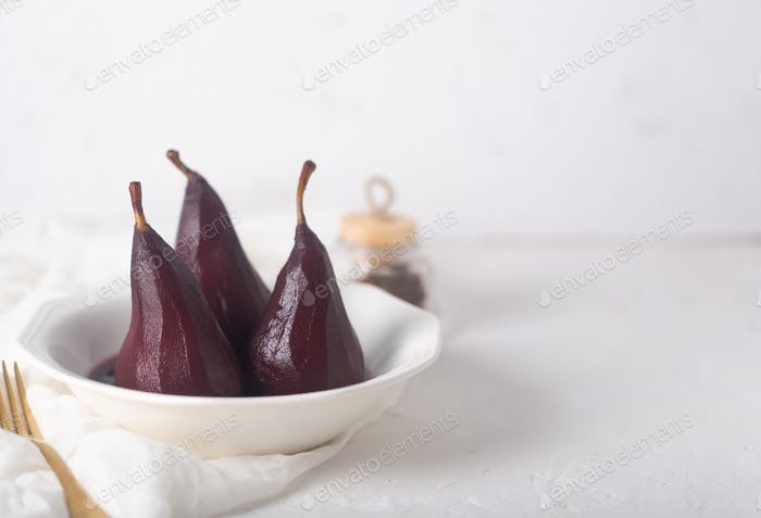 Poached Pears in red Mulled Wine Syrup With Cinnamon and Anise
