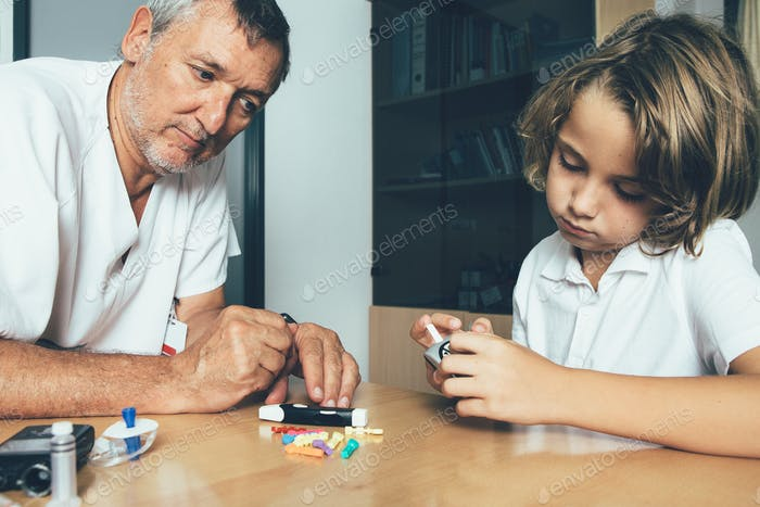Doctor watches a diabetic child