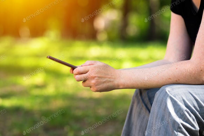 Thumbnail for Woman texting on mobile phone