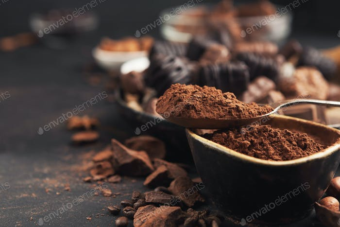 Cocoa bowl and crushed chocolate pieces on gray background