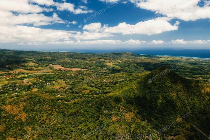 Bird's-eye view of the mountains and fields of the island of Mauritius.Landscapes Of Mauritius