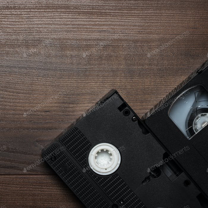 Old Retro Video Tape Over Wooden Background