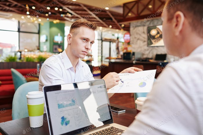 Businessman showing monthly financial report