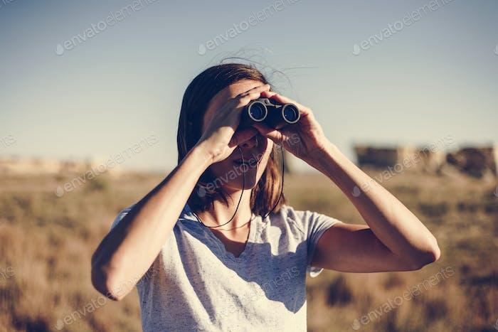 Traveler Using Binoculars