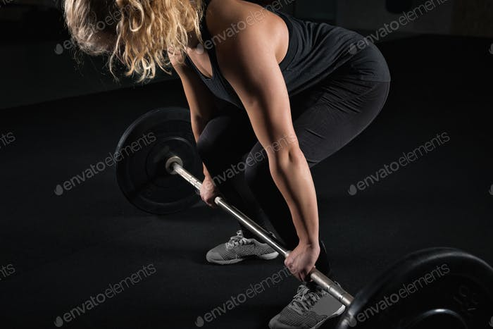 Sporty Female Lifting Weights