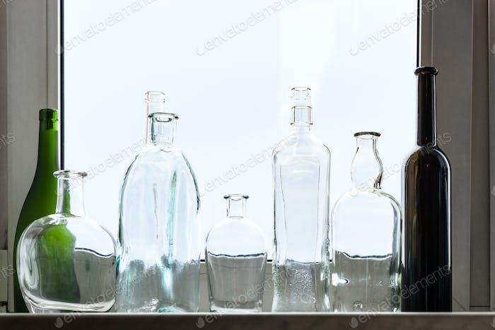 many empty drunk bottles on home window sill