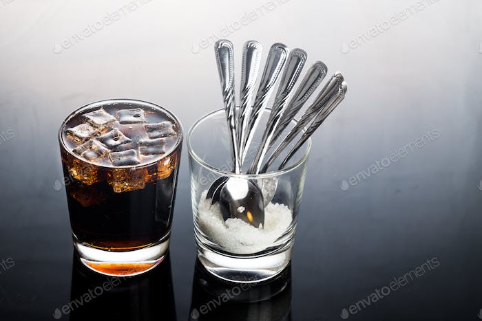 Concept of fizzy cola drinks with unhealthy sugar content