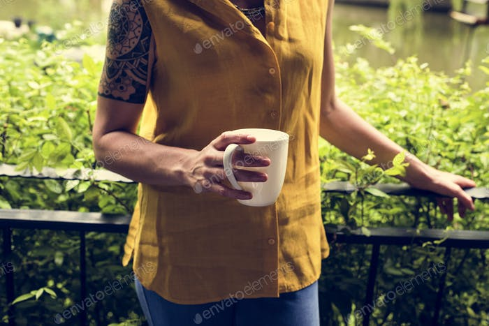 Woman's holding a mug