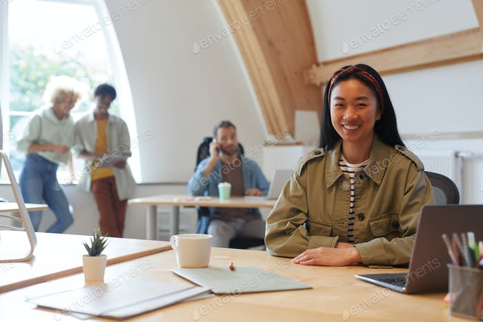Asian woman working at office