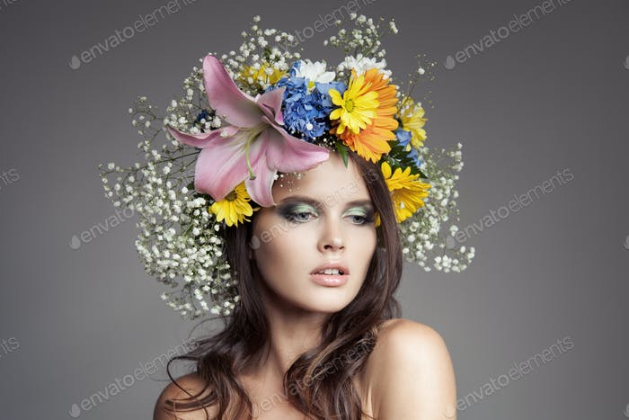 Beautiful Woman With Flower Wreath On Her Head.