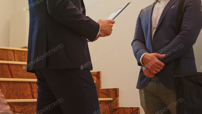 Close up of two business men in suit shaking hands