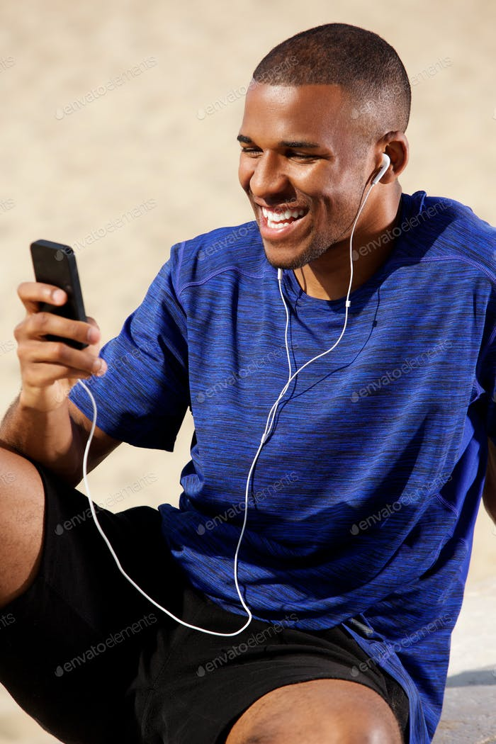 Fit young man listening music