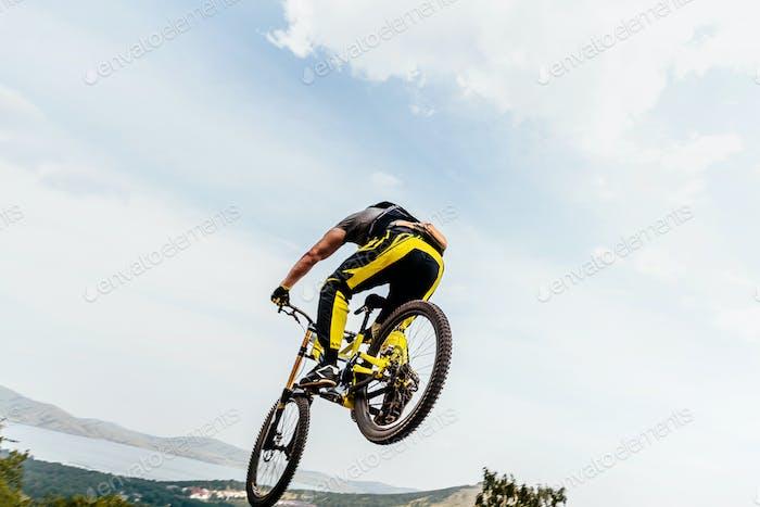 cyclist jump mountain biking