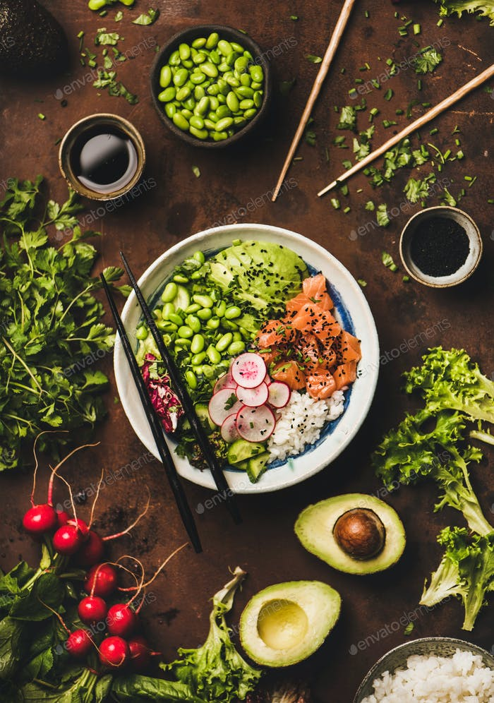 Salmon poke bowl or sushi bowl with vegetables and greens