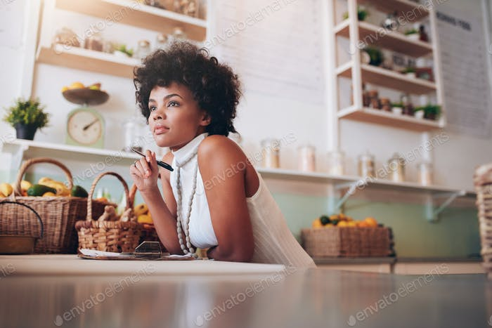 Young african female juice bar owner