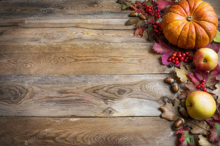 Thanksgiving or fall greeting with orange pumpkins, berries and