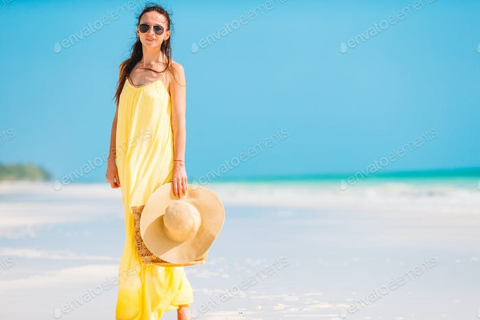Young fashion woman in dress on the beach