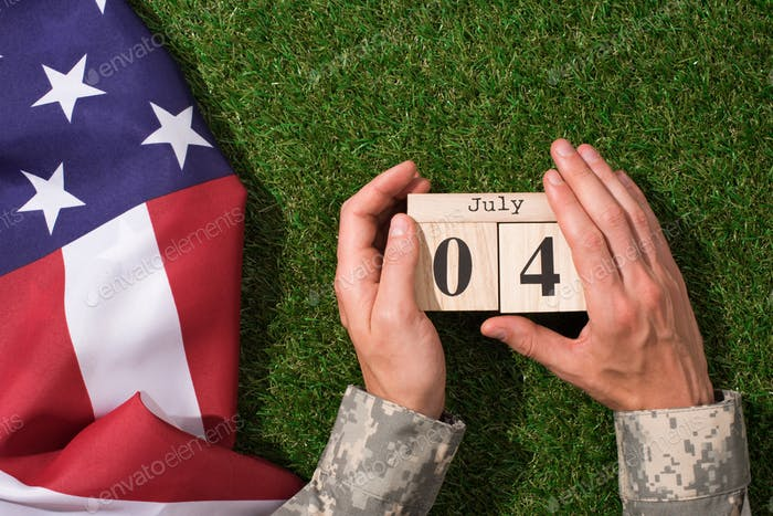 Soldier in Military Uniform Holding Calendar With 4th July Date