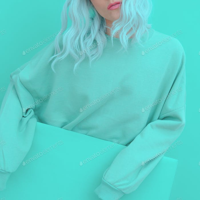 Girl in Fresh Mint Fashion clothing. Minimal aesthetic monochrome design. Aqua menthe color trend