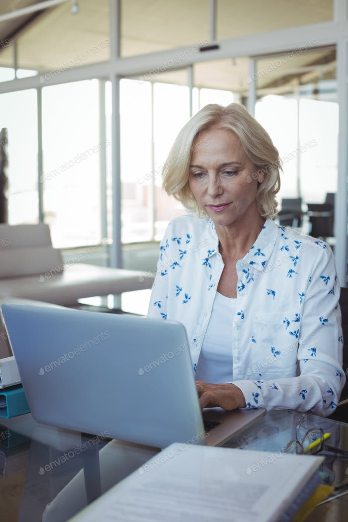 Focused entrepreneur working on laptop at office