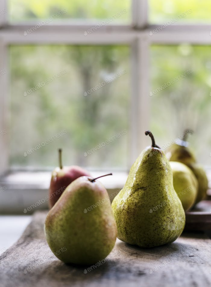 Closeup of fresh pears on wooden table