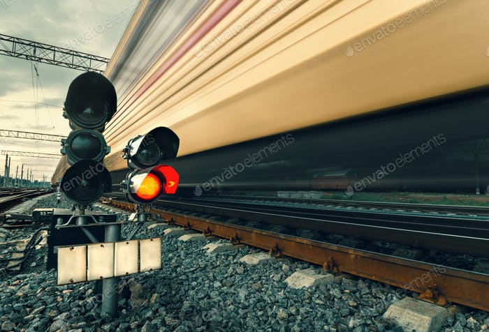 High speed passenger train on tracks with motion blur effect at