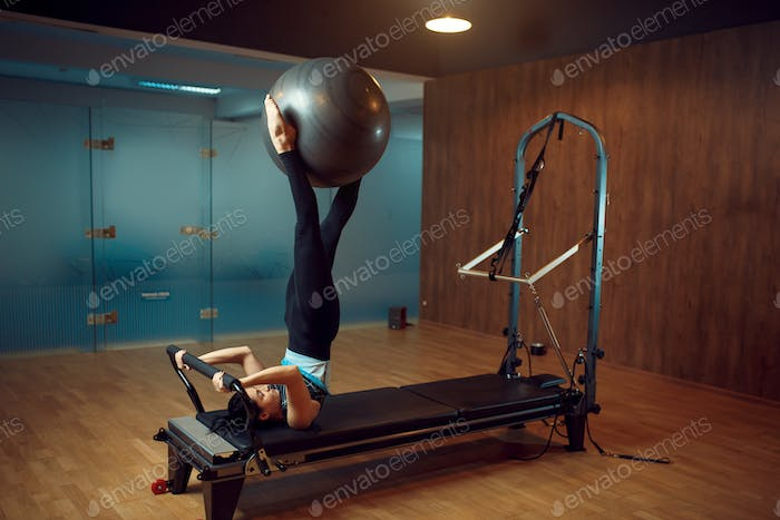 Slim woman, pilates training with ball in gym