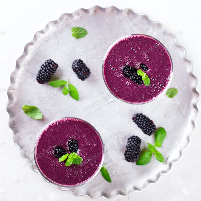 BlackBerry smoothie with Fresh Berries in glasses.