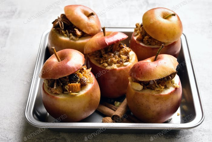 Baked apples with granola, cinnamon, nuts