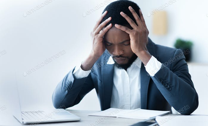 Bankruptcy. Frustrated black businessman depressed after fail at work