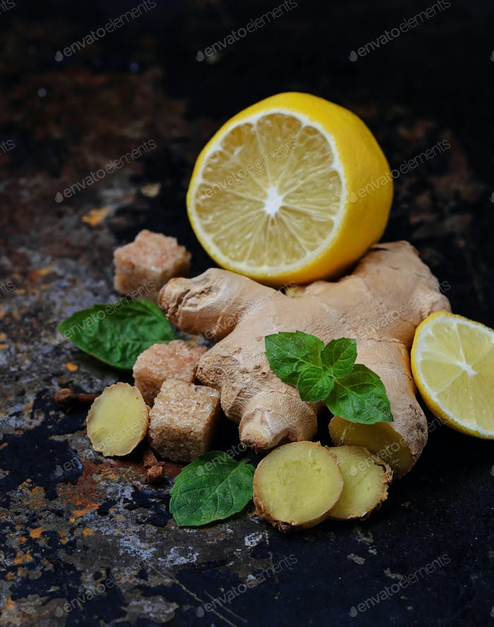 Ginger, lemon and mint on old dark background