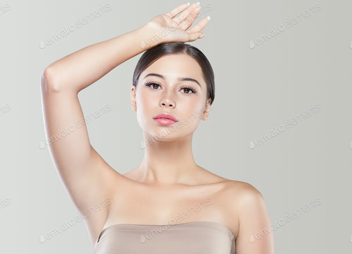 Armpit woman healthy skin depilation concept woman hand up. Color bakcground.