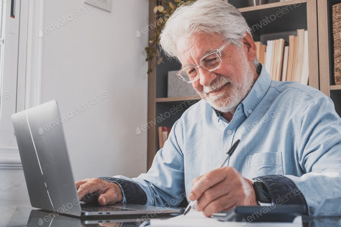 Happy old caucasian businessman smiling working online watching webinar podcast