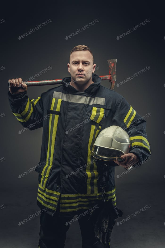 Firefighter costume holding helmet and recue red axe.