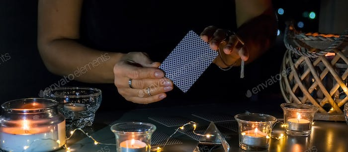 Tarot cards, Fortune telling on tarot cards at night by candlelight, magic crystal,