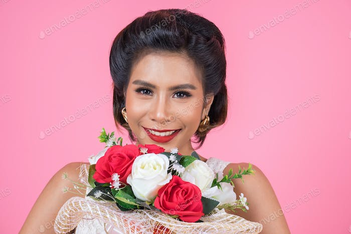 Happy Fashion women and Bouquet of flowers